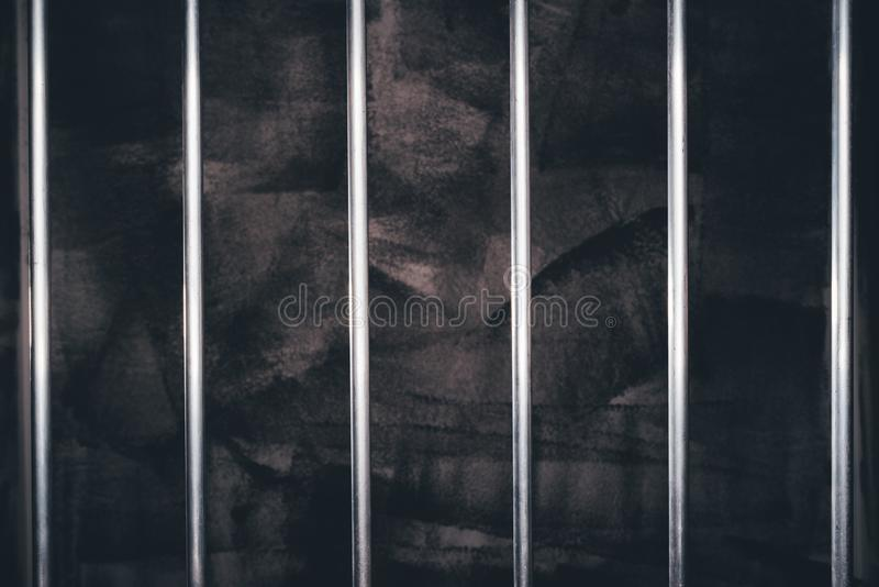 Jail bars, empty dark prison cell. As conceptual background for crime and punishment stock images