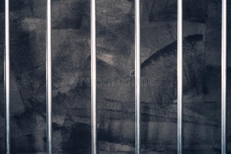 Jail bars, empty dark prison cell. As conceptual background for crime and punishment royalty free stock images