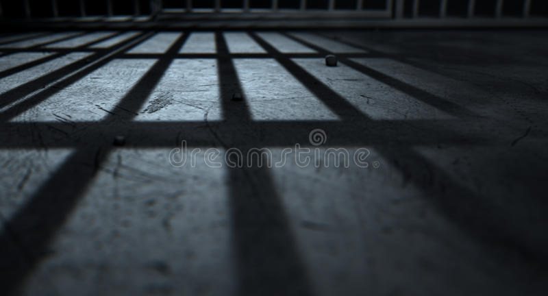 Jail Cell Bars Cast Shadows. A closeup of view of a jail cells iron bars casting shadows on the prison floor with copy space stock image
