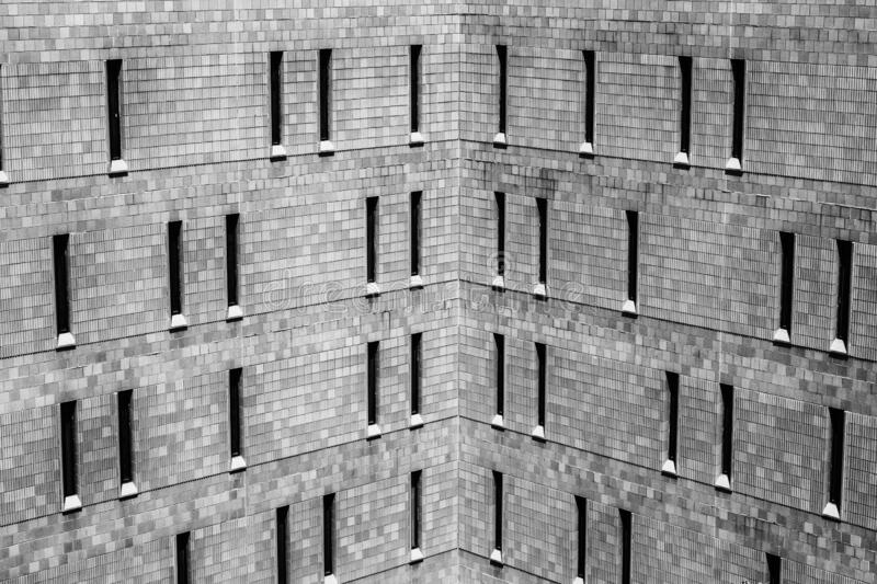 Jail or Prison harsh brick exterior. Thin windows let in a minimum of light and offer maximum security. Jail or Prison harsh brick exterior. Thin windows let in stock image