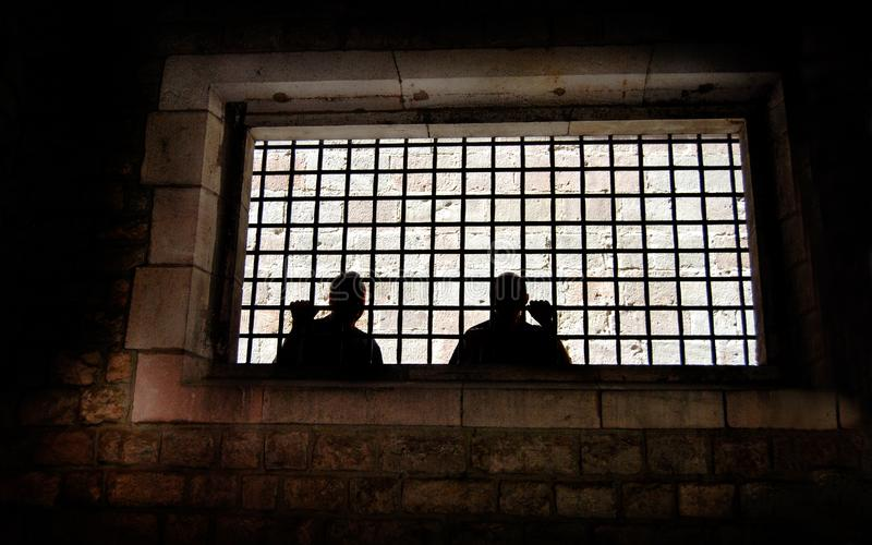 Jail Window Men Behind Bars royalty free stock photography