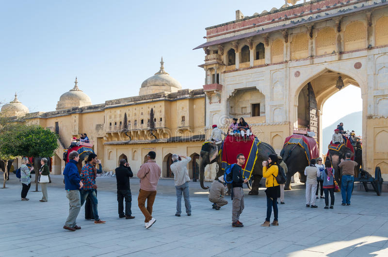 Jaipur, India - December 29, 2014: Tourists enjoy elephant ride in the Amber Fort. On December 29, 2014, Amber Fort was built by Raja Man Singh I in Jaipur royalty free stock image