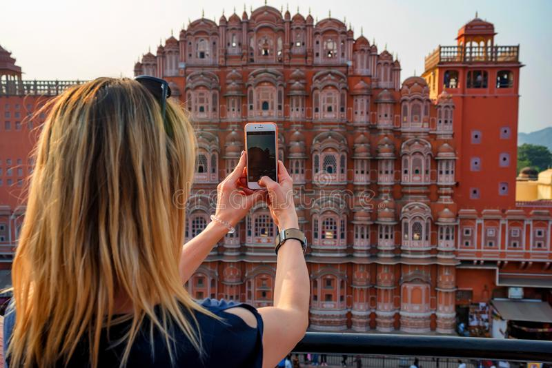 JAIPUR, INDIA - NOVEMBER 5, 2017: Young woman takes picture of Hawa Mahal, India royalty free stock photography