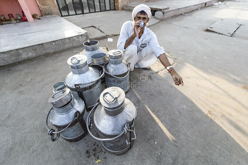 Jaipur, India-September 09, 2015:Daily traditional milk market a. T the street of Jaipur, India. Cow milk is drinks a day in India royalty free stock image