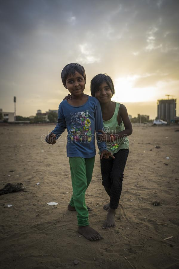 Portrait of young poor children in India. Jaipur, Rajasthan / India - 03 24 2019, Portrait of young children, Poor kids in the slum area of the city royalty free stock photography