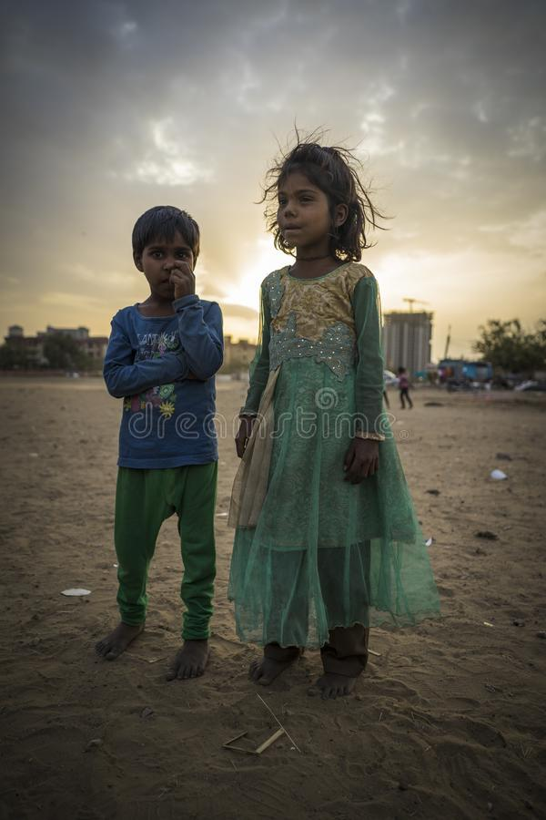 Portrait of young poor children in India. Jaipur, Rajasthan / India - 03 24 2019, Portrait of young children, Poor kids in the slum area of the city stock images