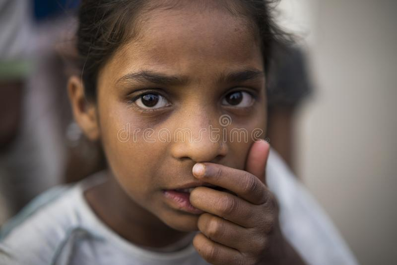Portrait of young poor girl in India. Jaipur, Rajasthan / India - 03 24 2019, Portrait of young girl, Poor child in the slum area of the city royalty free stock photography