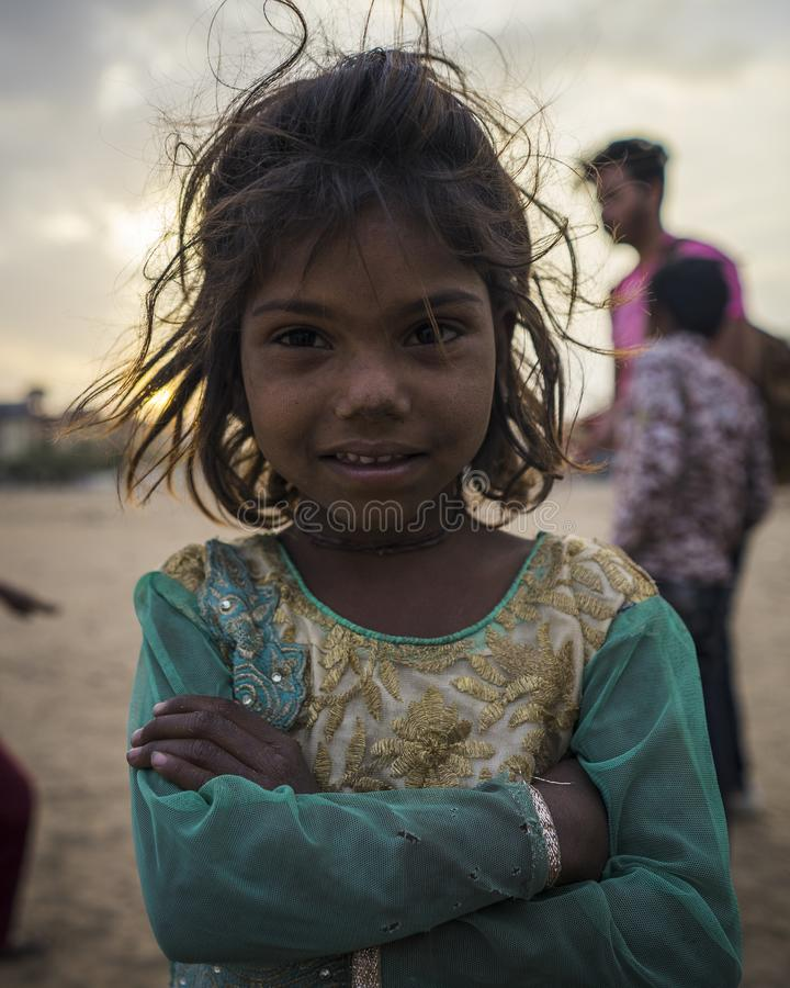 Portrait of young poor girl in India. Jaipur, Rajasthan / India - 03 24 2019, Portrait of young girl, Poor child in the slum area of the city royalty free stock images