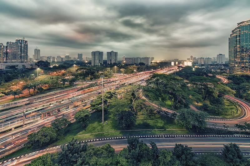 Jakarta city capital of Indonesia. Sunset over Jakarta city downtown royalty free stock photography