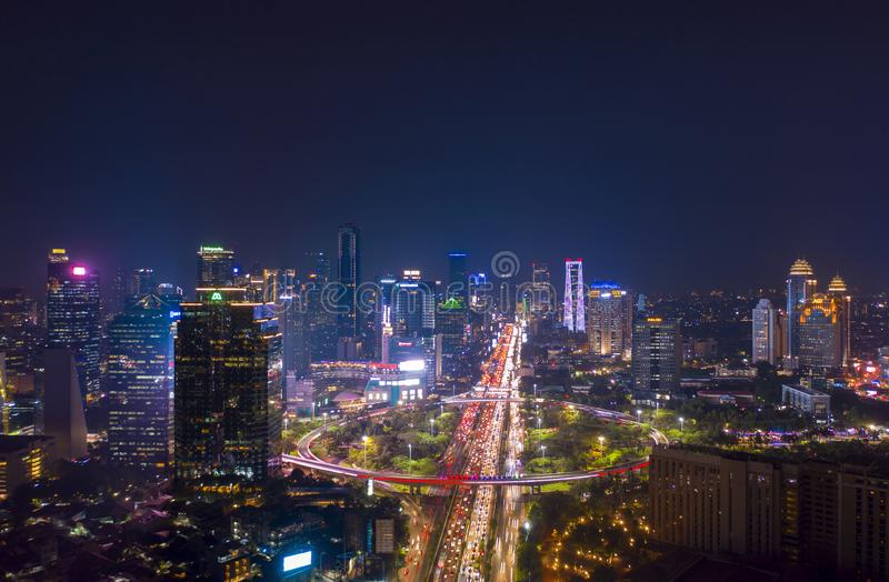 Jakarta city with glowing lights in hectic traffic. JAKARTA - Indonesia. November 09, 2018: Aerial view of Jakarta city with glowing lights in hectic traffic at royalty free stock photos