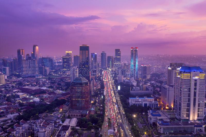 Jakarta cityscape with traffic jam after sunset. JAKARTA - Indonesia. February 18, 2019: Jakarta cityscape after sunset with hectic traffic and skyscrapers stock photos