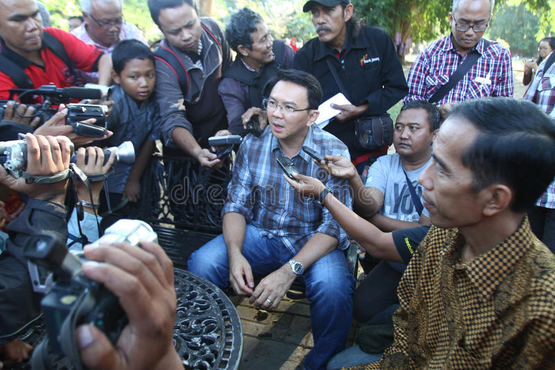 Jakarta governor election. Jakarta governor candidate, jokowi (left) and his vice governor candidate, ahok visiting the open park in Solo, Central Java royalty free stock photography