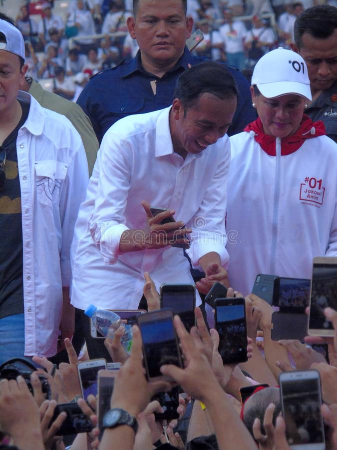 Candidates for President Joko Widodo campaign in front of hundreds of thousands of supporters at GBK Senayan. Jakarta, Indonesia - April 13, 2019: Candidates stock images