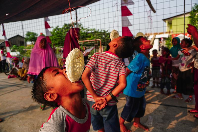 Jakarta, Indonesia - August 17, 2018: portrait of indonesia crackers eating competition on independence day celebration royalty free stock image