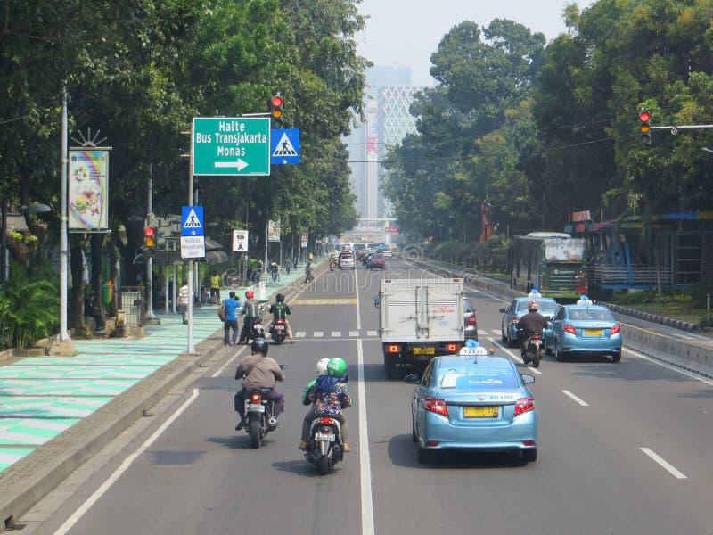 Jakarta city street. JAKARTA, INDONESIA - August 2, 2018: Traffic on Jalan Merdeka Barat royalty free stock images