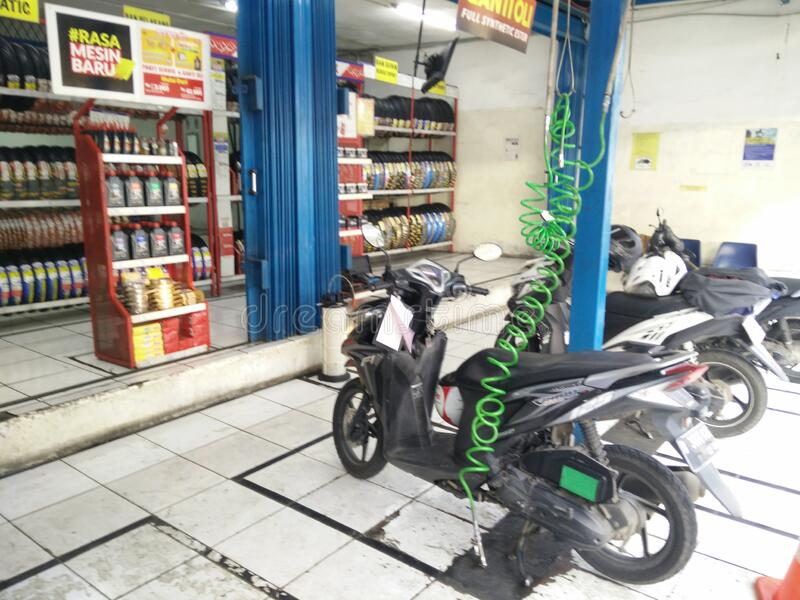 Jakarta/ Indonesia - February 3 2020: motorcycle in line on service center bengkel motor during rush hours. Bengkel stock photography