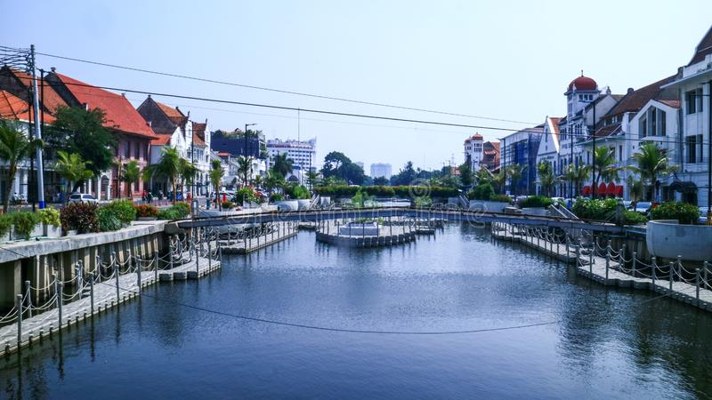 Riverbank in Jakarta. Jakarta, Indonesia - July 10, 2019: Riverbanks of Krukut River along Jl. Kali Besar Timur and Jl. Kali Besar Barat in Old City area turned stock images