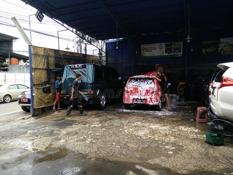 Jakarta, Indonesia - March 3, 2020: Car wash activities,. Cucian Mobil royalty free stock photography