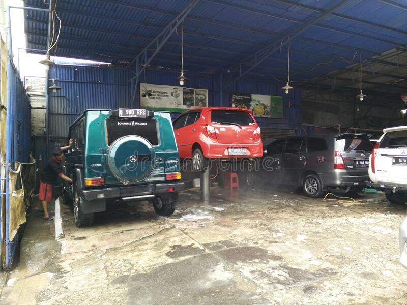 Jakarta, Indonesia - March 3, 2020: Car wash activities,. Cuci mobil royalty free stock image