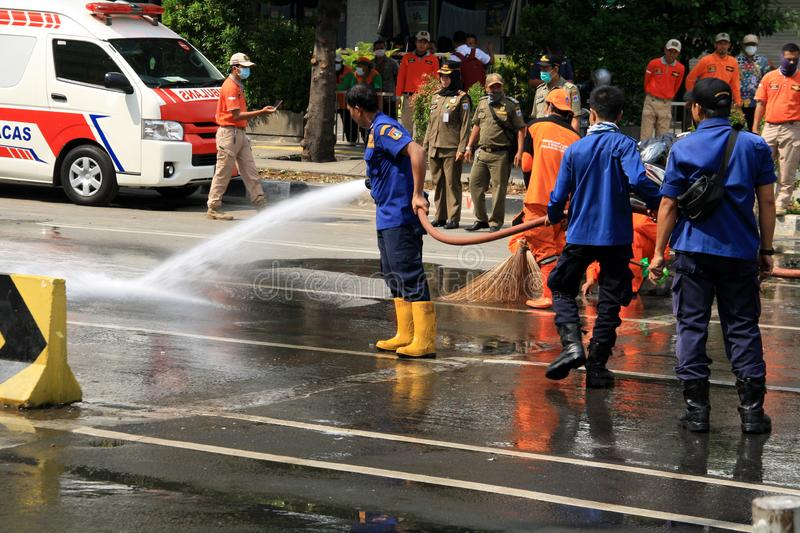 Cleaning Road in Jakarta. Jakarta, Indonesia - May 23, 2019: Officers cleared Jalan MH Thamrin after the Jakarta riots on May 22 royalty free stock image