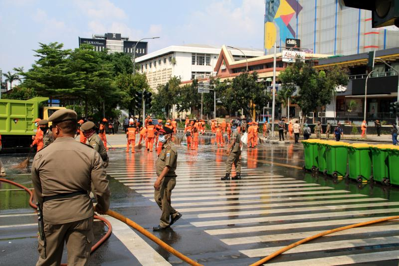 Cleaning Road in Jakarta. Jakarta, Indonesia - May 23, 2019: Officers cleared Jalan MH Thamrin after the Jakarta riots on May 22 stock photo