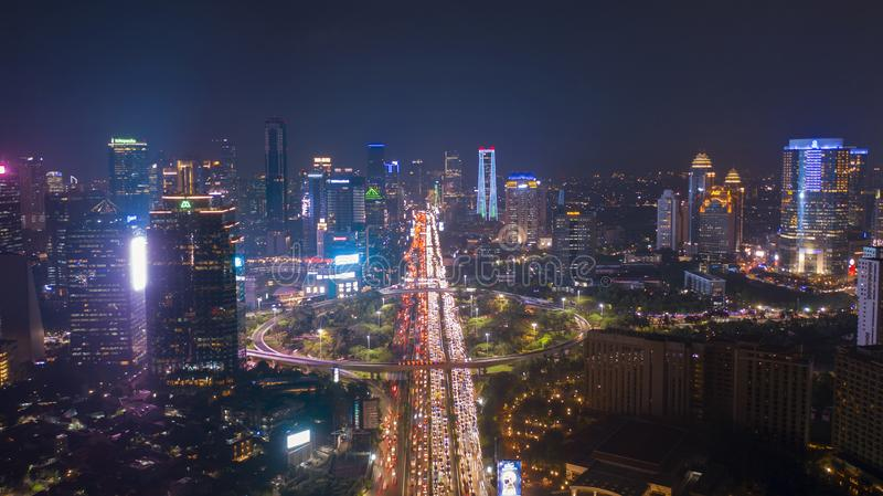 Night view of Jakarta city with heavy traffic royalty free stock photo