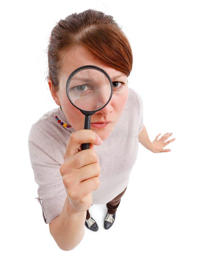 jako detektywistycznego magnifier poważna kobieta obraz royalty free