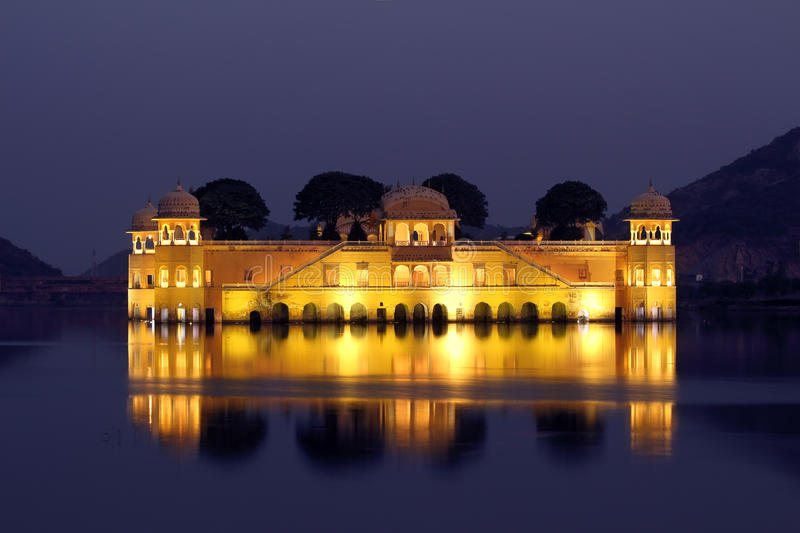 Jal mahal palace on lake at night in India stock photography