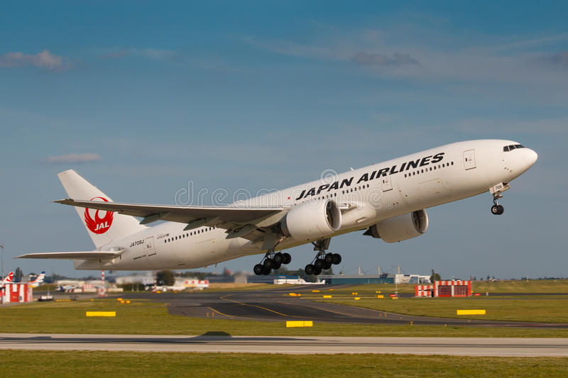 JAL. PRAGUE - JULY 17: B777 Japan airlines take off from PRG in Prague, CZE on July 17, 2017. Japan Airlines JAL operates almost 900 daily flights royalty free stock photos