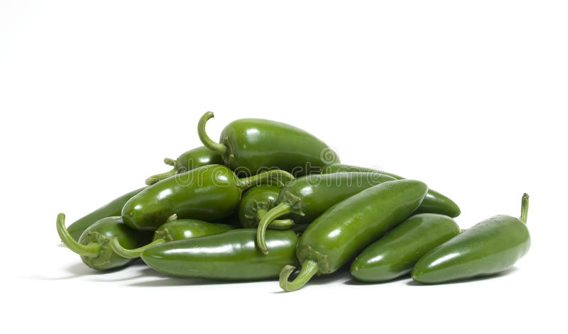 Jalapeno Peppers. A bunch of hot jalapeno peppers on white background royalty free stock photos