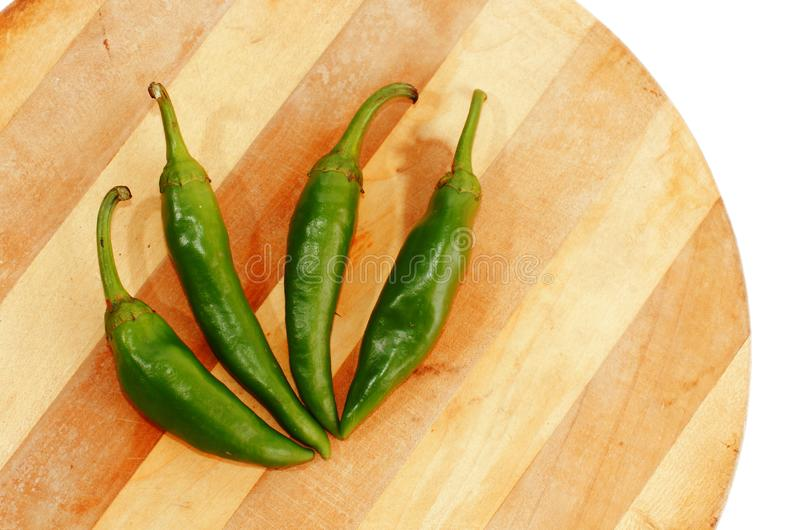 Jalapeno peppers. Hot jalapeno chilly peppers on wood plate royalty free stock images