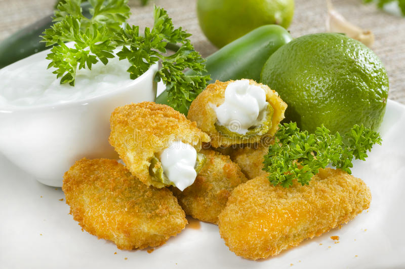 Jalapeno poppers. Mexican-american jalapeno poppers served with lime stock images