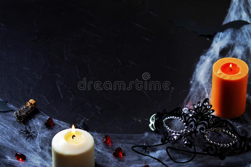 jalloween accessories:black mask, spider web, candles, poison bottle and spiders . Flat position, top view, copy space. horizontal stock photos