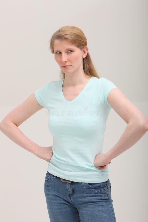 Jaloerse blonde vrouw stock fotografie