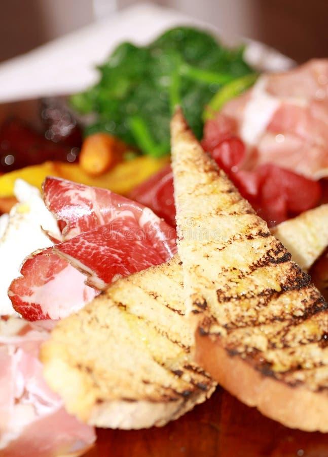 Jamón y tostada de Prosciutto foto de archivo