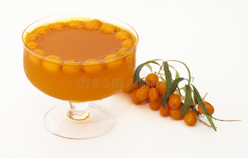 Jam from berries of sea buckthorn. On a white background royalty free stock photos