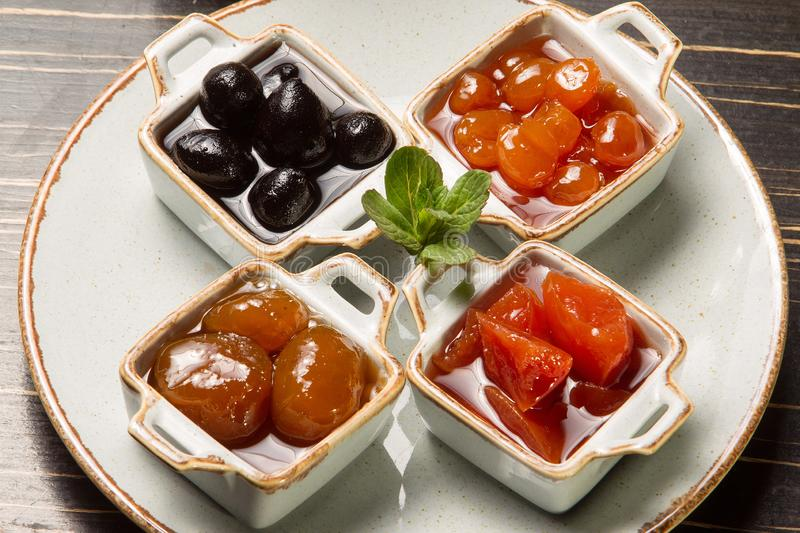 Jam from different fruits. On table royalty free stock images
