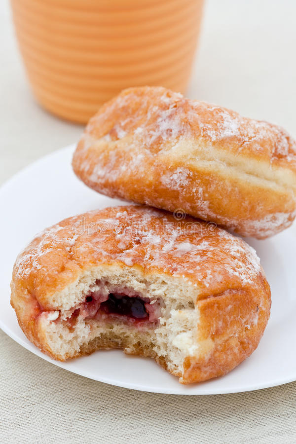 Free Jam Donut With Bite Taken Out Stock Image - 13370871
