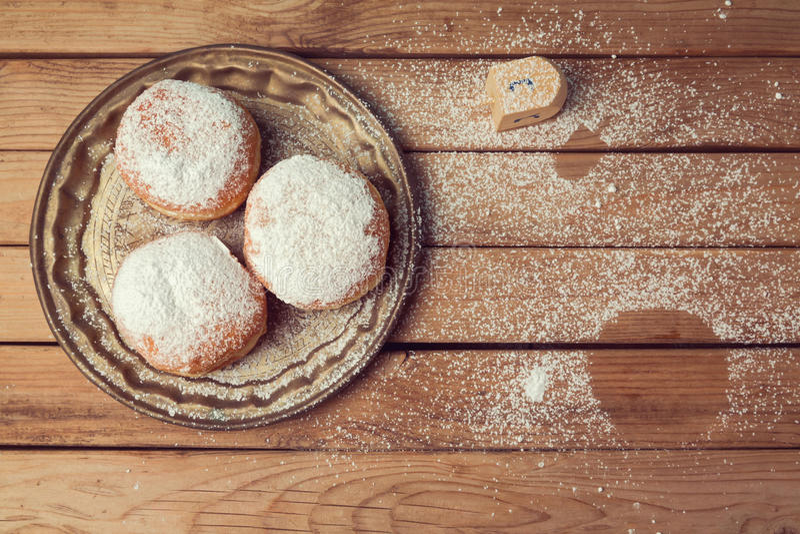 Jam doughnuts with icing sugar for Hanukkah holiday celebration royalty free stock photo