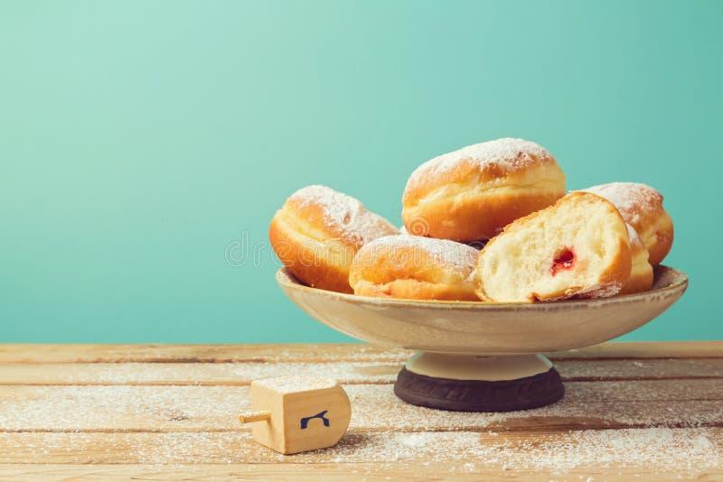 Jam doughnuts with icing sugar for Hanukkah holiday celebration stock photo