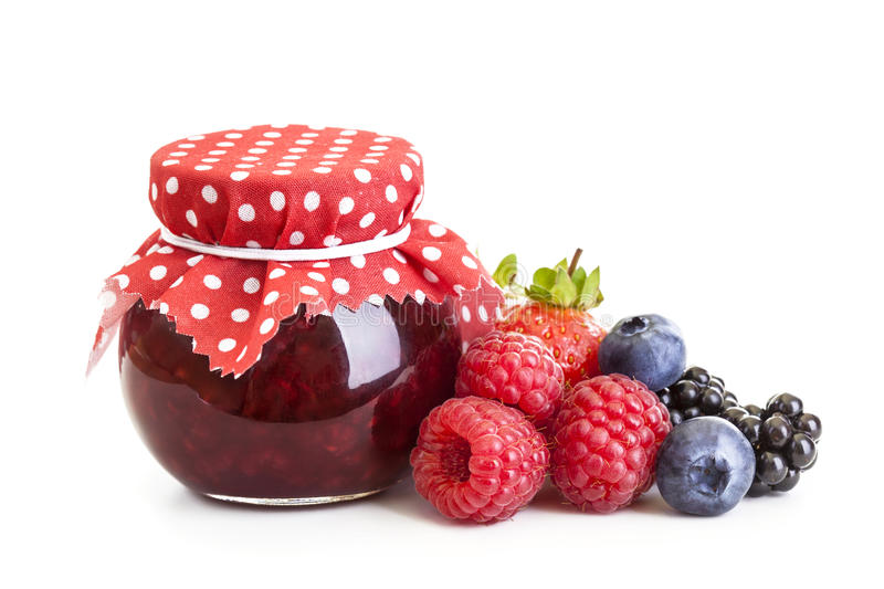 Jam and fresh berries stock images
