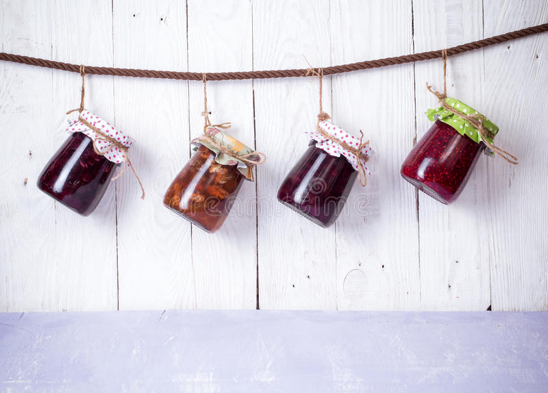 Jam in glass bank. Homemade jam in jar on wood background. healthy organic and vegan food stock photos