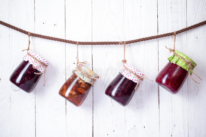 Jam in glass bank. Homemade jam in jar on wood background. healthy organic and vegan food royalty free stock images