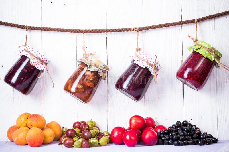 Jam in glass bank. Homemade jam in jar on wood background. healthy organic and vegan food royalty free stock photography