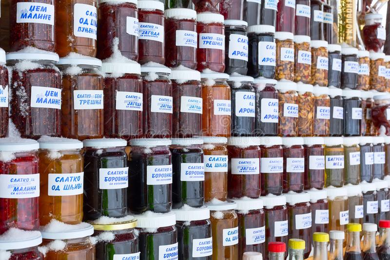 Jam and honey jars made of various fruit types in specialty market, Serbia royalty free stock photography