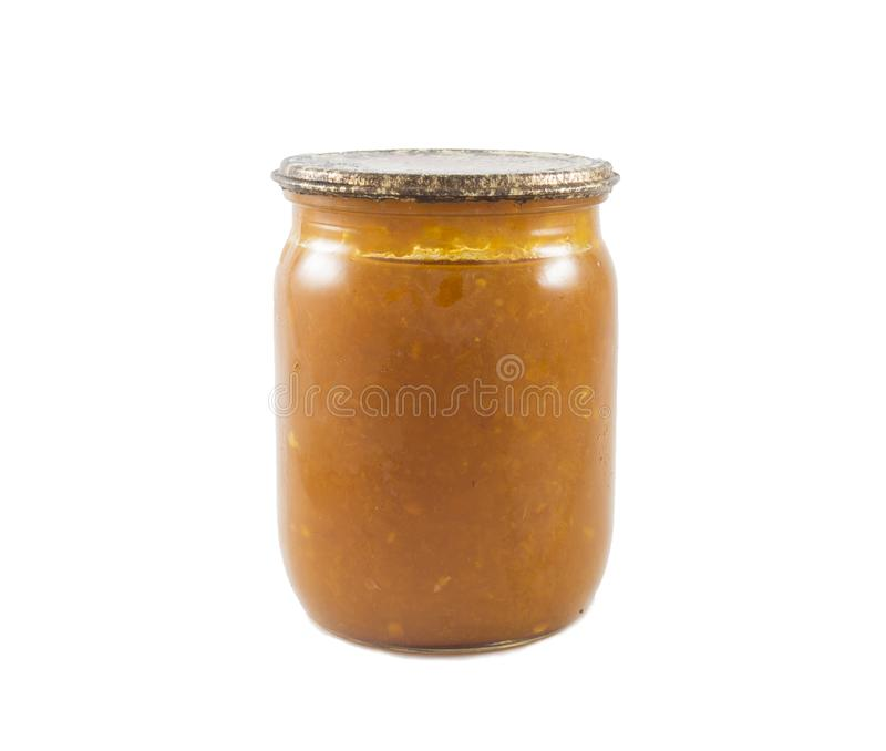 Jam made from oranges canned in the glass jar isolated stock photo