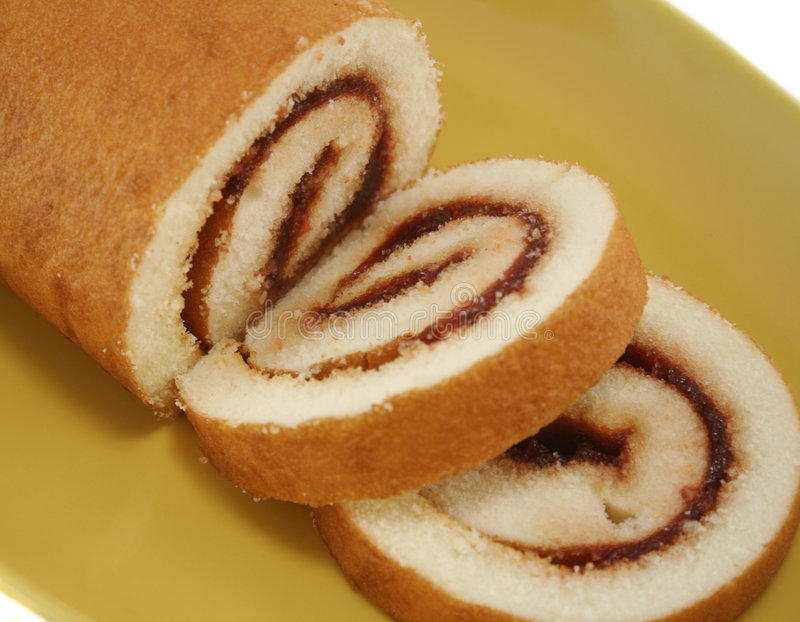 Jam Roll 3. Sliced strawberry jam roll ready to serve stock photography
