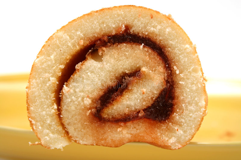 Jam Roll 4. Sliced strawberry jam roll ready to serve royalty free stock images