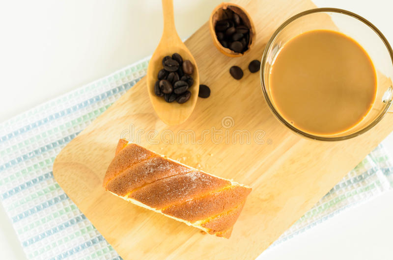 Jam Roll Cake. Slice Jam Roll Cake with coffee bean on Wood Plate royalty free stock photography