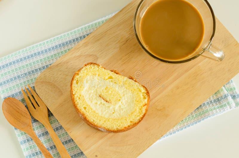 Jam Roll Cake. Slice Jam Roll Cake on Wood Plate royalty free stock photo